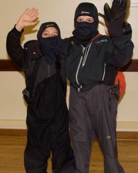 Alan Noghiu and Cosmo Adam, both from Year 5 at St Thomas More School try on the latest in polar fas