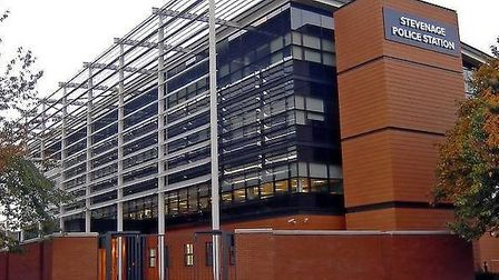 A woman held at Stevenage police station ended up in hospital after she took concealed medication th