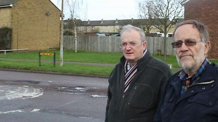 Herts County Council member Robin Parker and Liberal Democrat member Stephen Booth survey the damage