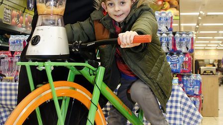 Edward Binns (6) of Saffron Walden with Dave Evansger Sue Ward trying out the smoothie cycle ride.