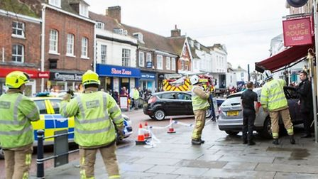 Firefighters and police at the scene of the crash at Café Rough in Hitchin High Street. Picture: Sha