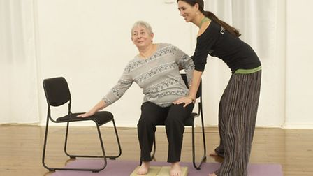 Val Crowther taking part in an adaptive yoga session with Jo Duffin.