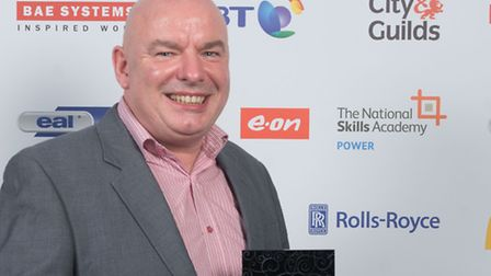 Neil Cain with his Apprenticeship Champion of the Year award.