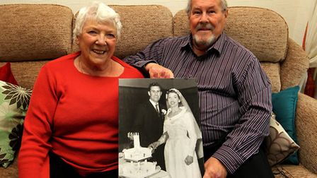 Marion and Alan Cooper, pictured at home in Letchworth, with their Wedding photograph, celebrate the
