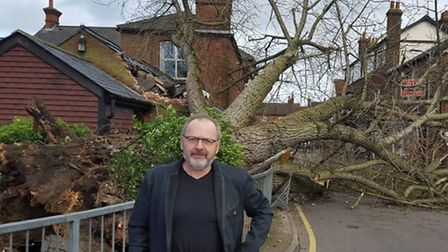 Eyewitness Andrew Yates in front of the fallen tree in Drapers Way, Stevenage. Picture: Layth Yousif