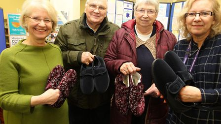 Councillor Teresa Heritage with Richard Jarvis and Janette Jarvis sporting their new slippers and li