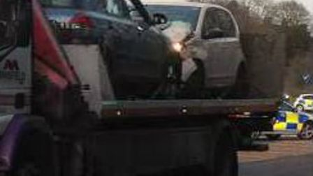 The two cars being taken away on a recovery truck after the crash at the Graveley junction on the ou