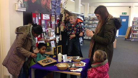 Families add their stories to the memorial tree to commemorate Holocaust Memorial Day