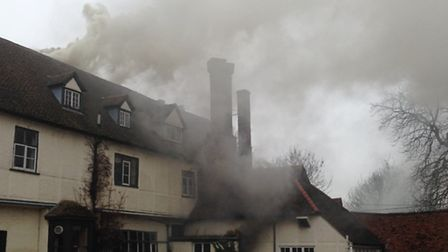 Firefighters work to fight the blaze at the Redcoats Farmhouse Hotel.