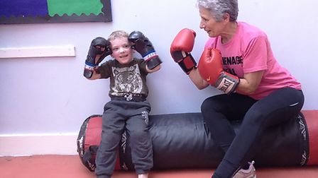 Tylor Lincoln, four, the youngest member of the group and Caroline Berkley, 62, its oldest member.
