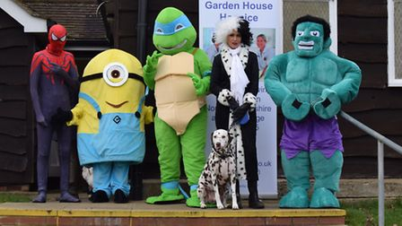 Garden House Hospice supporters and volunteers taking part in the Muddy Mutts and Superheroes walk o