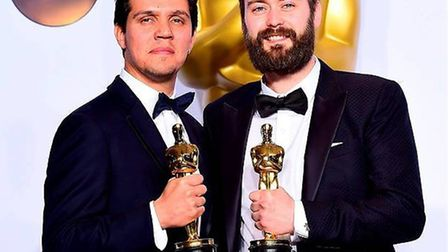 Shan Christopher Ogilvie and director Benjamin Cleary with their Oscars for the short film Stutterer