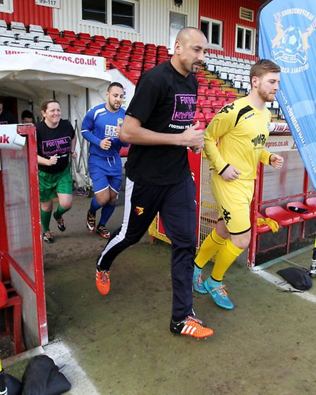 Players run onto the pitch for the match for police football homophobia campaign launch
