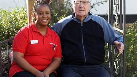Precious Phiri, Deputy Manager and Roy Tindall, resident at Burleigh House care home