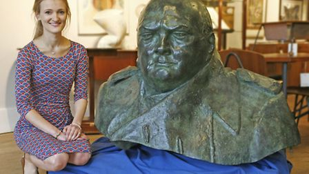 """Sylvia Ewen, from Sworders Auctioneers, with the """"monumental"""" bust"""