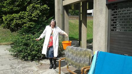 Jo Ward the museum's curator bailing out flood water after the heavy rain in July last year.