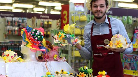 Hobbycraft assistant manager James Wheatley with the Easter bonnets.