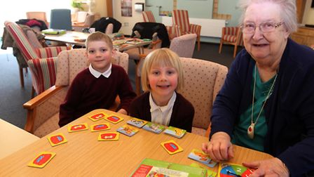 Pupils, Ruben and Katie with resident, Isobel at Fred Millard Court