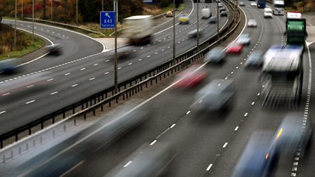 File photo of traffic on the M1 motorway, as the number of telematics or 'black box' insurance polic