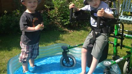 Cameron Oliver makes a splash with his younger brother Jacob at their Stevenage home.