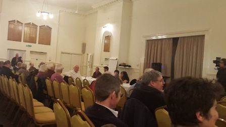 The audience assembles for a meeting on Hitchin Town Hall at The Sun Hotel.