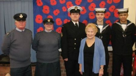 Hitchin Royal British Legion Poppy Appeal Organiser Mary Prowse with air cadet officers, a sea cadet