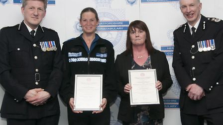 PCSO Anne Charters and Gwen Slack with their awards, pictured alongside former deputy Chief Con Andy