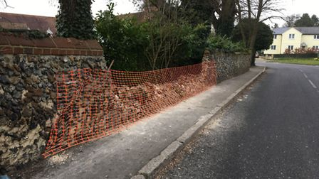 The wall in Steeple Bumpstead damaged by the crash.