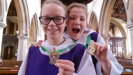 Rosie Morgan-Males and Amelia Ryden, both 11, with their bronze dean's medals.