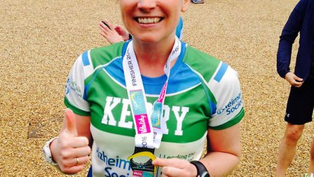 Kerry White, picture after completing the Vitality North London Half Marathon, is running the London