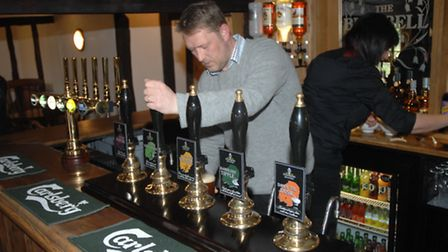 Saffron Brewery's James Hoskins pulls the first pint at the Bluebell Inn's reopening