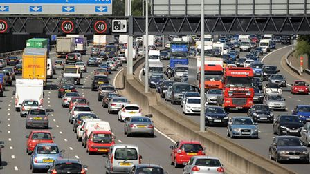 File photo of motorists starting to queue in heavy traffic on the M25 (Andrew Matthews/PA)