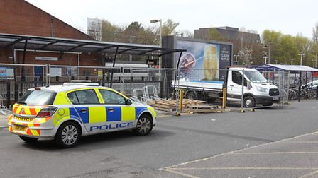 A police car at Stevenage railway station, not far from where a woman was hit by a train. Officers