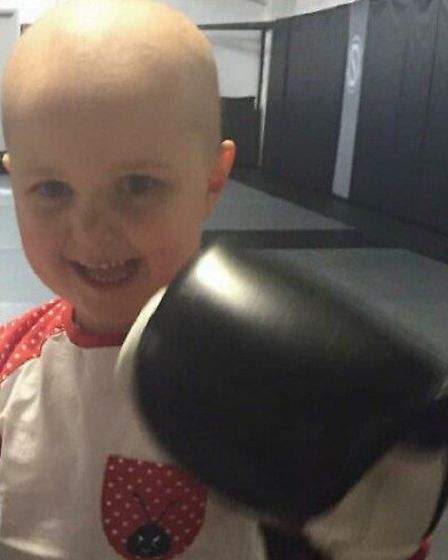 Fighter Izzi Ferns is the family's inspiration for competiting in the Tough Mudder challenge, so the