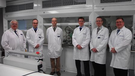 Founder John McGregor (far left) with son Robert (far right) and employees at Contamac in Saffron Wa