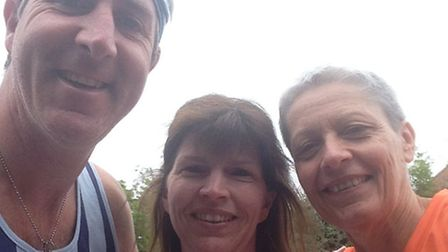 Barry King, Tricia Hopper and Karen Liddle after a Spartan run last year.