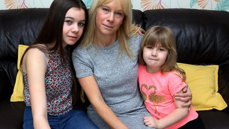 Katie Fisher pictured with her two daughters, Maddie and Lois, was devastated after the dog attack i