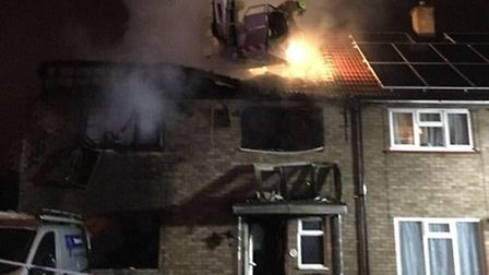 A Herts fire aerial platform team tackle the blaze in Cavell Walk, Stevenage. Picture: @ReqsFireDog