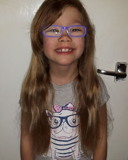 Amber was eager to donate her long hair to children with cancer after watching a video on Youtube.