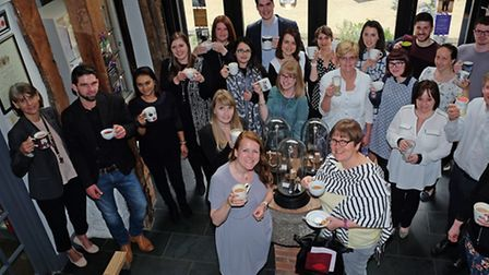 Owner Harriet Kelsall with her staff and visitors at the fairtade coffee morning