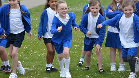 A mix of year 2, 3 and 4 children take part in the Race for Life event