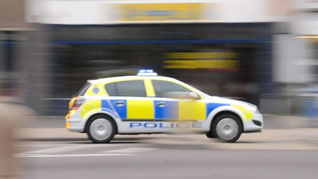 A motorist evaded police by running through a red traffic light on Tuesday