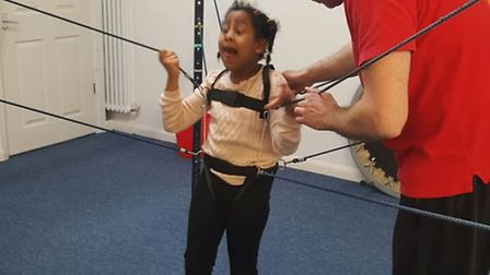 Sienna Houghton needs specialist treatment and equipment to help her walk by herself.