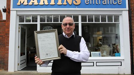 Martins manager Stephen White outside the Leys Avenue store with one of the 1936 invoices.