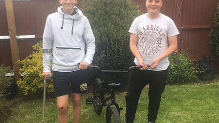 Jack Howard, right, visits Chris Chipperfield to return his BMX bike after he was released from hosp