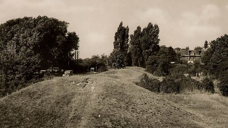 A view from Six Hills in the 1930s, with traffic on the Great North Road to the left and Daneshill v