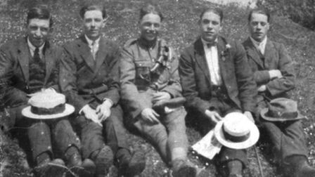 Five young men sitting on one of the Six Hills for a photo in about 1920.
