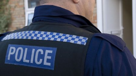 Two attackers threatened an 80-year-old man with a knife and slashed his hand.