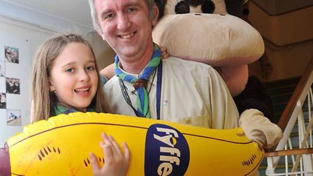 Assistant beaver scout leader Chris Wells with Pippa and part cub leader, part monkey Eddie Fuller.