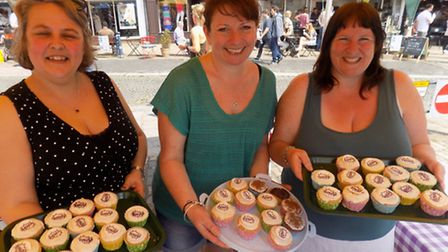 Fair In The Square, Hitchin - Parents of Wilshere-Dacre Academy sold decorated cakes. Left to right